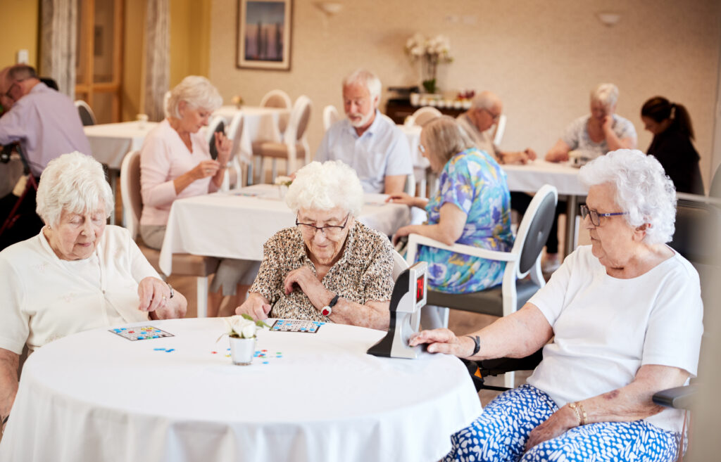 seniors playing bingo in assisted living facility