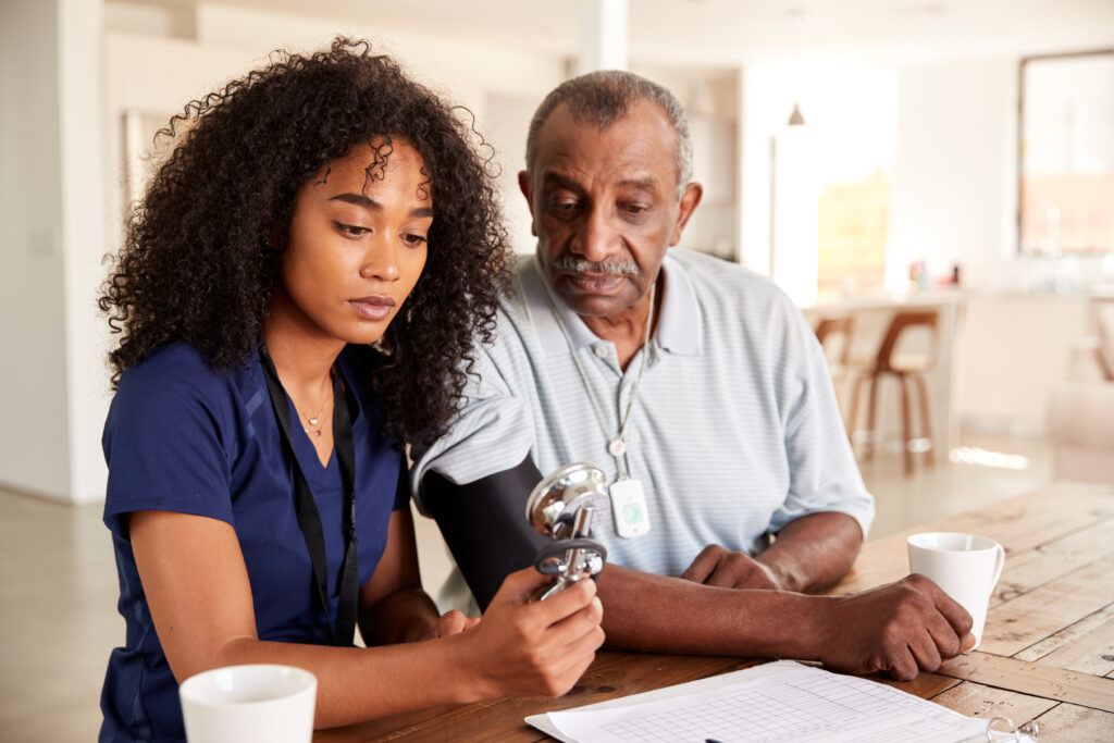 black caregiver with senior in adult day care