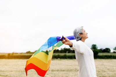 lgbt woman with gay pride glag