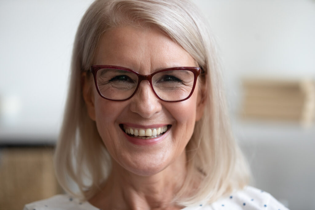 senior woman with dental and vision coverage