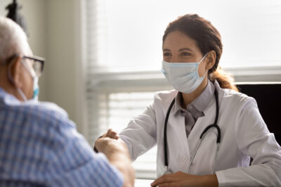 senior with medicare eligibility man visiting doctor