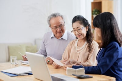 senior couple with insurance agent