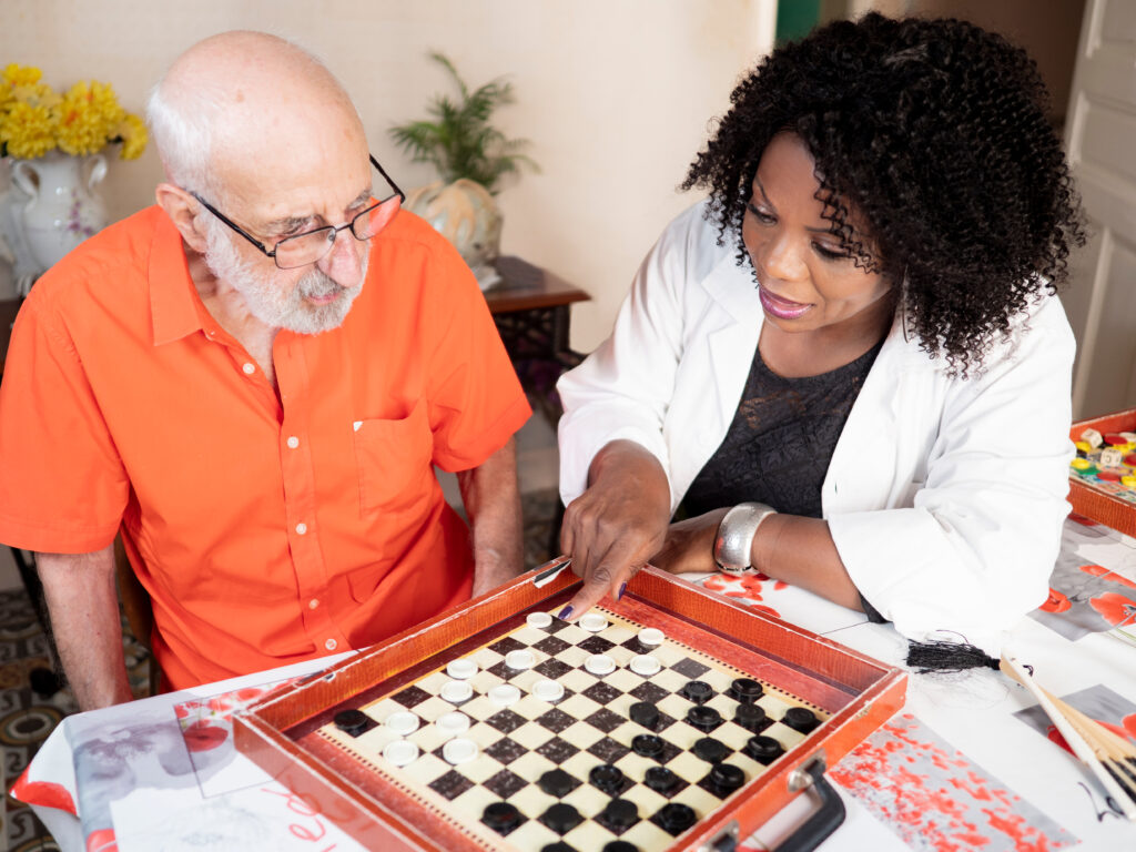 volunteer caregiver playing checkers